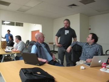 Brian Hamlin, David Gould, Steve Crawford, Josh Berkus and Dirk working on reviewing patches