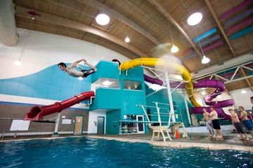 Indoor swimming pool water slides 20 and 30 somethings in portland awesome stuff portland - Cool indoor pools with slides ...