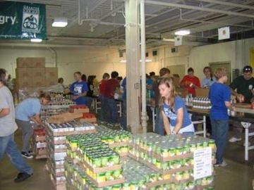 Volunteers repacking food